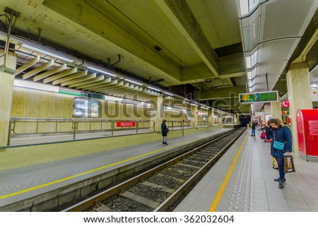 BRUSSELS, BELGIUM - 11 AUGUST, 2015: Inside Beurs train station platform showing few people waiting. - stock photo