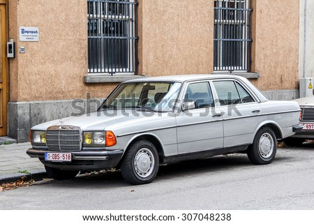 BRUSSELS, BELGIUM - AUGUST 9, 2014: Motor car Mercedes-Benz W123 E-class at the city street. - stock photo