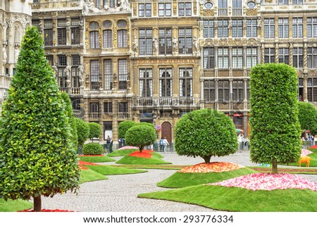 BRUSSELS, BELGIUM-AUGUST 15, 2013: Temporary garden installed to decorate Grand Place during Floralientime art action in medieval city hall. - stock photo