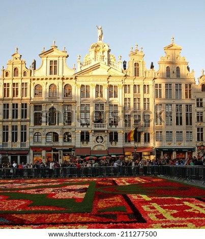 BRUSSELS; BELGIUM; 16 AUGUST 2014 Thousands of Tourists gather alongside the Brussels Flower Carpet on the main city square Grand Place - stock photo