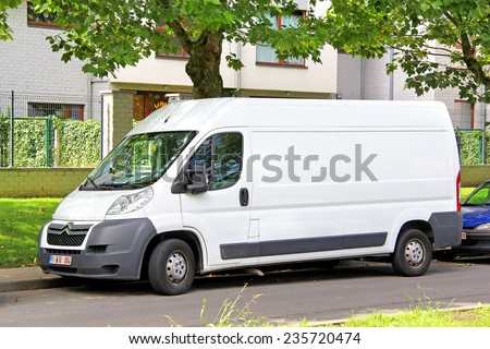 BRUSSELS, BELGIUM - AUGUST 9, 2014: White cargo van Citroen Jumpy at the city street. - stock photo