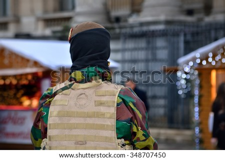 BRUSSELS, BELGIUM-DECEMBER 1, 2015: Armed soldier protects Christmas Market in center of Brussels