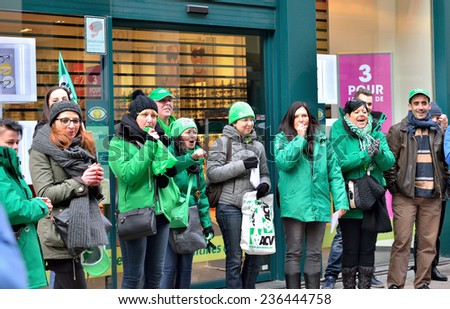 BRUSSELS, BELGIUM-DECEMBER 8, 2014: Participants of National Strike explaining their protests to people - stock photo