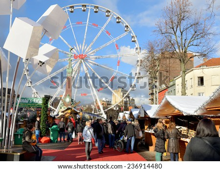 BRUSSELS, BELGIUM-DECEMBER 6, 2014: People crowded very popular Christmas market on square Vismet - stock photo