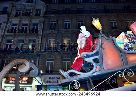 BRUSSELS, BELGIUM-DECEMBER 14, 2014: Saint Nicholas greets public during Christmas Parade defile in frame of Winter Wonders events moves by boulevard Anspach - stock photo