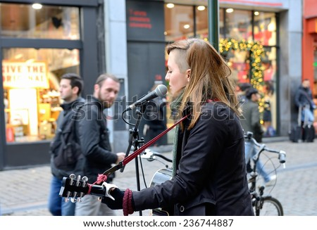 BRUSSELS, BELGIUM-DECEMBER 6, 2014: Street singers in historical center of Brussels are one of the attractions of the old city