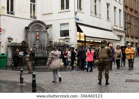 BRUSSELS, BELGIUM - DECEMBER 1: Touristic area hosting the famous statue of Manneken Pis being guarded by a Belgian soldier due to security alert . December 1, 2015 in Brussels, Belgium.