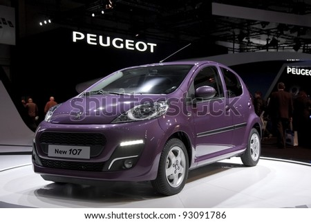 BRUSSELS, BELGIUM - JANUARY 12: Annual autosalon brussel 2012 auto motor show in Heyzel expo hall.  Peugeot 107 on display. Show iopen for public  January 13-22. January 12, 2012 in Brussels,  Belgium - stock photo