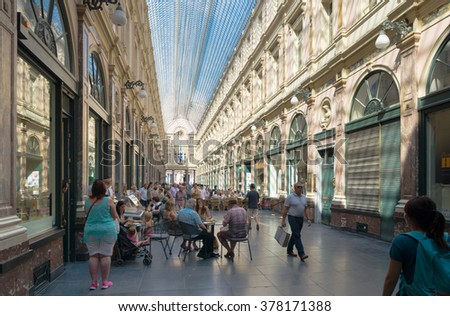 BRUSSELS, BELGIUM - JULY 11, 2015: Interior of The Galeries Royales Saint-Hubert (French) or Koninklijke Sint-Hubertusgalerijen (Dutch), a glazed shopping arcade in Brussels