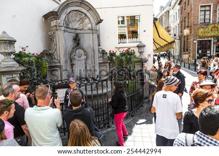 BRUSSELS, BELGIUM - JULY 6: Manneken Pis statue in Brussels. Statue of a pissing boy in a beautiful summer day in Brussels, Belgium on July 6 2014 - stock photo