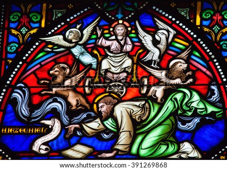 BRUSSELS, BELGIUM - JULY 26, 2012: Stained glass window depicting Cherubim and Chariot vision of the Prophet Ezekiel in the cathedral of Brussels. - stock photo