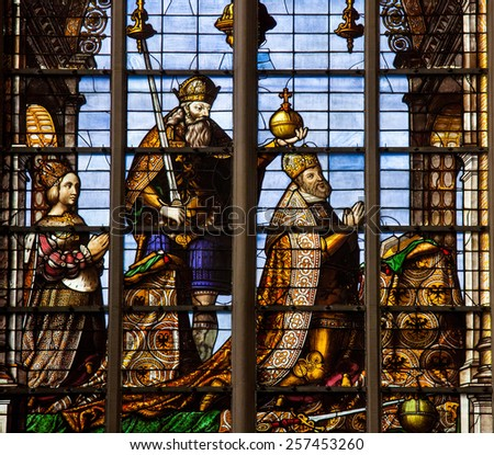 BRUSSELS, BELGIUM - JULY 26, 2012: Stained Glass window depicting Emperor Charles V  (16th Century) and his wife, Isabella of Portugal, in the Cathedral of Brussels, Belgium. - stock photo