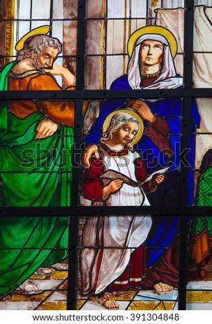 BRUSSELS, BELGIUM - JULY 26, 2012:  Stained glass window depicting the Holy Family,Joseph, Mary and Jesus, in the cathedral of Brussels, Belgium. - stock photo