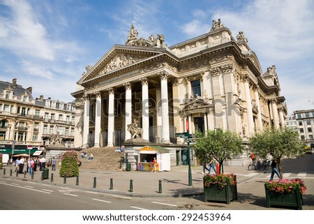 Brussels, Belgium - 2014, July 22 : The Brussels stock exchange building with people on the street, Belgium