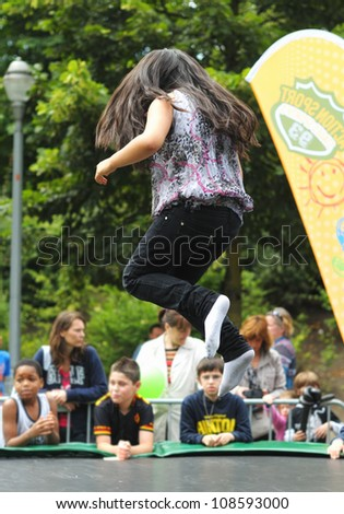 BRUSSELS, BELGIUM - JULY, 21: Unidentified minor jumping on trampoline during National Day of Belgium activities for children on July 21, 2012 in Brussels.