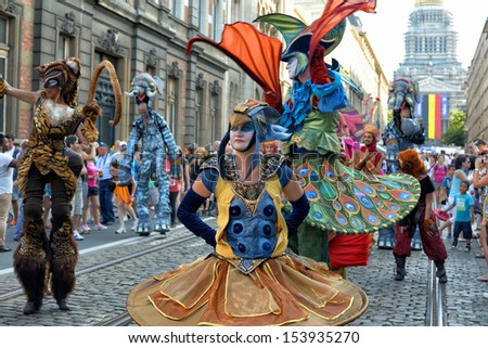 BRUSSELS, BELGIUM-JULY 21: Unidentified street actors play scene in defile during Belgian National Day activities on July 21, 2013 in Brussels. - stock photo