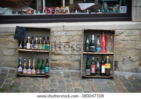BRUSSELS, BELGIUM - JULY 12, 2015: Various Belgian beers in front of a touristic beer shop. In Belgium there are about 130 breweries in the country, which produce about 1000 different beers.