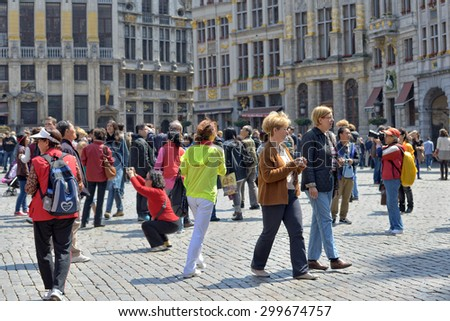 BRUSSELS, BELGIUM-JUNE 01, 2013: Groups of foreign and local tourists crowded Grand Place in Brussels, one of mostly visited sites in the world