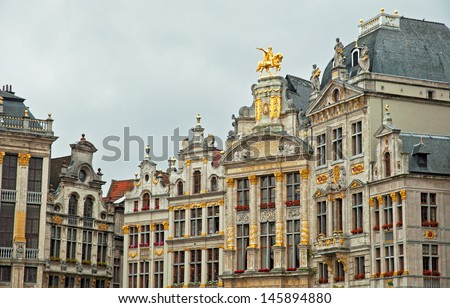 BRUSSELS, BELGIUM - 28 JUNE: Houses of the famous Grand Place on 28 June 2013, Brussels, Belgium. Grand Place was named by UNESCO as a World Heritage Site in 1998.