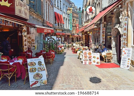 BRUSSELS, BELGIUM-JUNE 2, 2014: Restaurants in historical centre of Brussels are ready to accept first visitors of the day. - stock photo