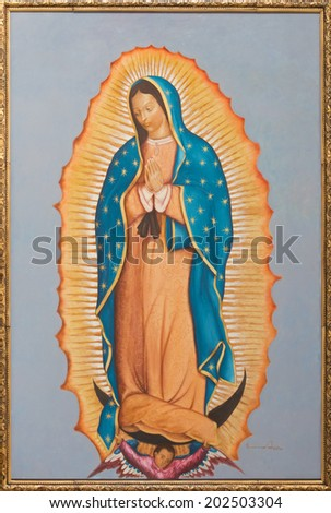 BRUSSELS, BELGIUM - JUNE 15, 2014: The paint of Virgin Mary of Guadalupe by Ivone Calvo (2004) in church Notre Dame aux Riches Claires - stock photo