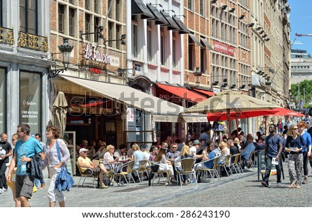BRUSSELS, BELGIUM-JUNE 06, 2015: Tourists crowded streets and cafes in historical center of Brussels - stock photo