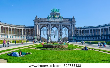 BRUSSELS, BELGIUM, MARCH 9, 2014: People are relaxing next to cinquantenaire monument in brussels during first sunny weekend in March. - stock photo