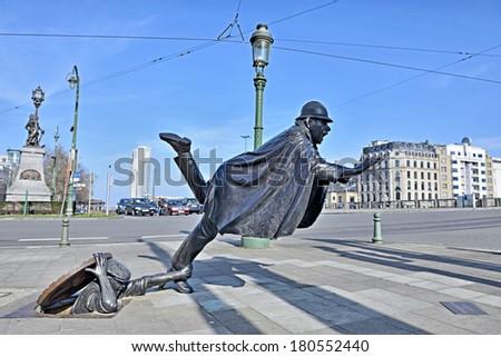 BRUSSELS, BELGIUM-MARCH 08, 2014: Sculpture De Vaartkapoen created in 1985 illustrating cartoon serial about Quick and Flupke.  - stock photo