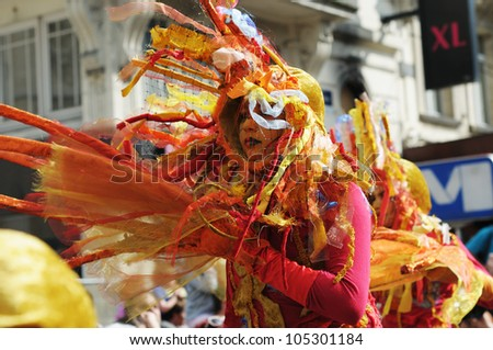 BRUSSELS, BELGIUM-MAY 19: An unknown participant shows costume of mystic creature during Zinneke Parade on May 19, 2012 in Brussels. This parade is a biennial urban artistic and free-attendance event - stock photo