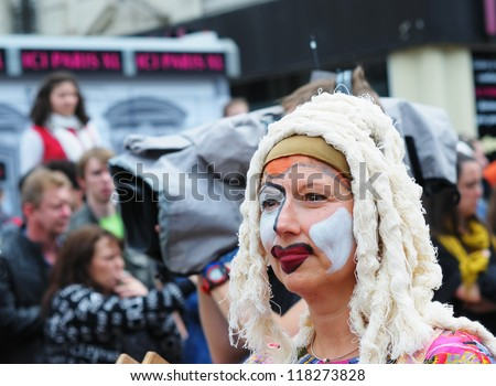 BRUSSELS, BELGIUM-MAY 19: an unknown participant shows her mystic costume in a composition at Zinneke Parade on May 19, 2012 in Brussels. This parade is a biennial urban free-attendance event. - stock photo