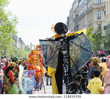 BRUSSELS, BELGIUM-MAY 19: an unknown participant shows her mystic costume in a composition at Zinneke Parade on May 19, 2012 in Brussels, Belgium. This parade is a biennial urban free-attendance event. - stock photo
