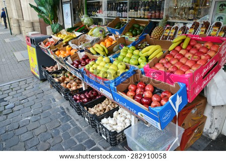 BRUSSELS, BELGIUM - MAY 21, 2015: Fruit and vegetable stand in Brussels promoting the organic products. - stock photo