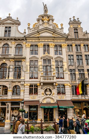 BRUSSELS, BELGIUM - MAY 11, 2014: Historical Buildings of the famous Grand Place (Grote Markt) - the central square of Brussels. Grand Place was named by UNESCO as a World Heritage Site in 1998. - stock photo