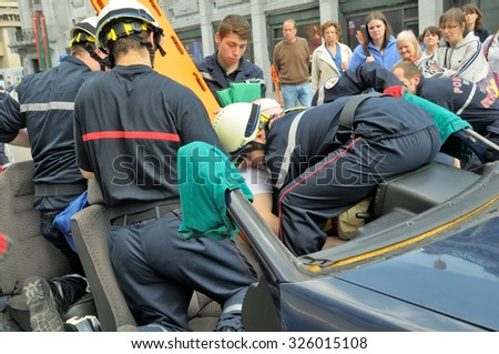 BRUSSELS, BELGIUM-MAY 5, 2013: Members of Belgian rescue service demonstrate their skills during annual Day of Iris - Fete de in Brussels. - stock photo