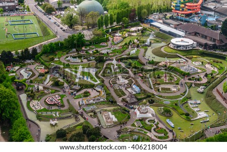 """BRUSSELS, BELGIUM - 07 MAY 2015: Panoramic view from the observation deck on the top level of the Atomium - the green trees, modern and historic buildings,  and miniature Park """"Mini Europe"""",  - stock photo"""
