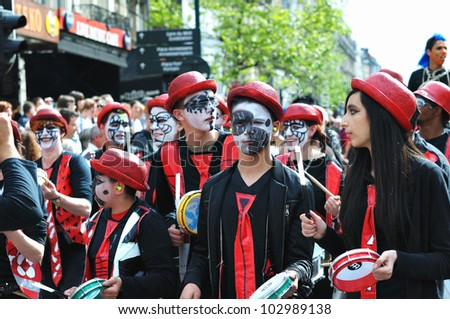 BRUSSELS, BELGIUM-MAY 19: Participants in fancy dresses greet visitors during Zinneke Parade on May 19, 2012 in Brussels. This parade is a biennial urban artistic and free-attendance. - stock photo