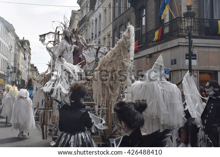 BRUSSELS, BELGIUM-MAY 21, 2016: Unidentified participant in her mystic outfit at the Zinneke Parade 2016. The biennial artistic parade is attracting thousands of visitors to watch this event. - stock photo
