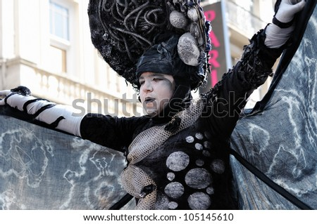 BRUSSELS, BELGIUM-MAY 19: Unknown participant demonstrate her mystic costume at Zinneke Parade on May 19, 2012 in Brussels, Belfium. This parade is an artistic biennial urban free-attendance event. - stock photo