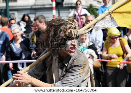 BRUSSELS, BELGIUM-MAY 19:  unknown participant plays his role in procession at Zinneke Parade on May 19, 2012 in Brussels. This parade is an artistic biennial urban free-attendance event. - stock photo