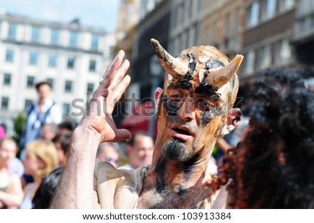 BRUSSELS, BELGIUM-MAY 19:  unknown participant plays his role of a devil during Zinneke Parade on May 19, 2012 in Brussels. This parade is a biennial urban artistic and free-attendance event. - stock photo