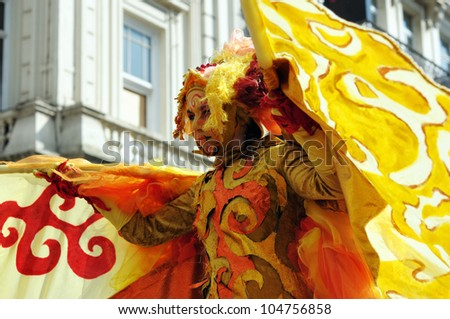 BRUSSELS, BELGIUM-MAY 19:  unknown participant shows his exotic costume at Zinneke Parade on May 19, 2012 in Brussels. This parade is an artistic biennial urban free-attendance event. - stock photo