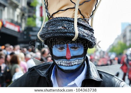 BRUSSELS, BELGIUM-MAY 19: Unknown participant shows his mystic makeup at Zinneke Parade on May 19, 2012 in Brussels, Belgium. This parade is an artistic biennial urban free-attendance event - stock photo