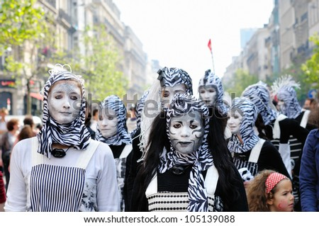 BRUSSELS, BELGIUM-MAY 19: Unknown participants demonstrate their costumes at Zinneke Parade on May 19, 2012 in Brussels, Belgium. This parade is an artistic biennial urban free-attendance event. - stock photo