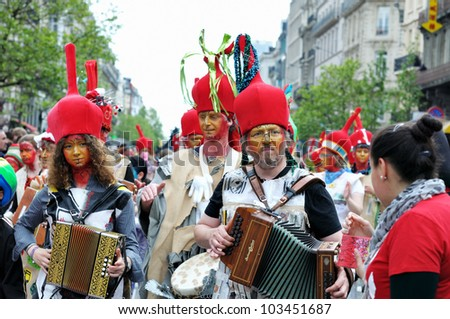 BRUSSELS, BELGIUM-MAY 19: Unknown participants in fancy dresses play music during Zinneke Parade on May 19, 2012 in Brussels. This parade is a biennial urban artistic and free-attendance event.