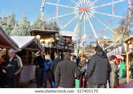 BRUSSELS, BELGIUM-NOVEMBER 29, 2014: Christmas Market in Brussels on Saint Catherine square, very popular between local people and tourists - stock photo