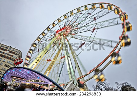 BRUSSELS, BELGIUM - NOVEMBER 30, 2014: Christmas Market in Brussels, Winter Wonders. Huge Ferris wheel in place Saint Catherine on November 30, 2014 in Brussels. - stock photo