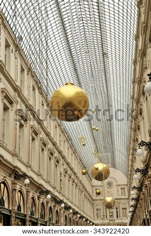 BRUSSELS, BELGIUM-NOVEMBER 20, 2015: Saint Hubert passage, very popular between local people and tourists, decorated for Christmas season - stock photo
