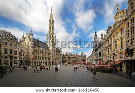 BRUSSELS, BELGIUM - SEPTEMBER 15 2013: Brussels city central square Grand Place surrounded by its Baroque style is part of UNESCO world heritage - stock photo