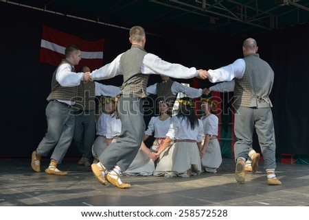 BRUSSELS, BELGIUM-SEPTEMBER 21, 2014: Brussels Latvian Dancers in an open air show on Vismet square  - stock photo