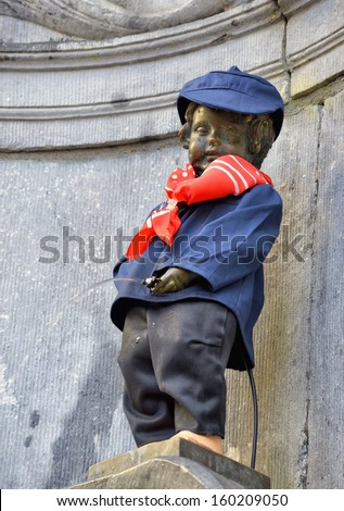 BRUSSELS, BELGIUM-SEPTEMBER 26: Manneken Pis awarded costume of folkloric personage of Schaerbeek Pogge on September 26, 2013 in Brussels, Belgium - stock photo